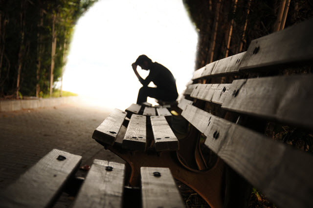 Depressed Man Sitting on a Bench.