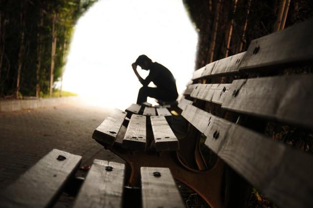 Depressed Man Sitting on a Bench.